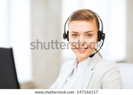 business, communication and call center - female helpline operator with headphones - stock photo
