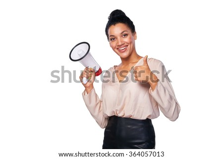 Business, communication, information concept. Confident smiling mixed race caucasian - african american business woman holding loudspeaker and gesturing thumb up sign - stock photo