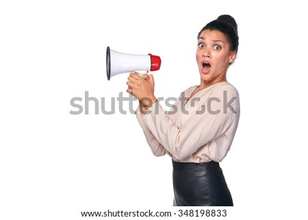 Business, communication, information concept. Surprised mixed race caucasian - african american business woman holding loudspeaker and looking with amazement at the camera - stock photo
