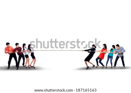Business competition - Business team struggling to win - stock photo