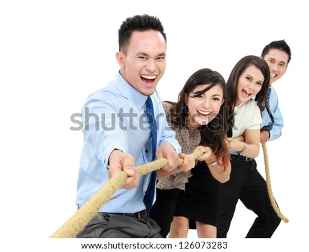 Business competition teams struggling to win. pulling rope on white background - stock photo