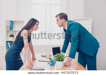 Business competition. Two colleagues having disagreement and conflict - stock photo