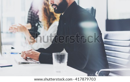 Business concept. Bearded businessman working investment startup project modern office.Typing text document contemporary laptop. Film effect. Blurred background, horizontal.  - stock photo