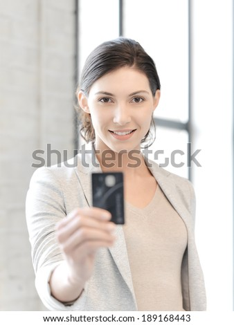 business concept - bright picture of happy woman with credit card - stock photo
