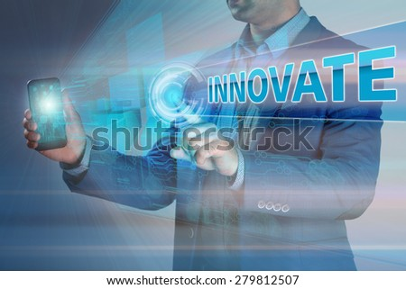 Business concept. Businessman holding smatrfon and click on the virtual display with the text innovation. - stock photo