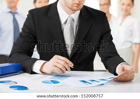 business concept - businessman working with papers - stock photo