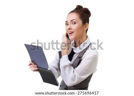 business concept - businesswoman talking on the phone and taking notes - stock photo