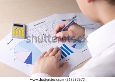 business concept - bussinessman accounting something with calculator in office - stock photo