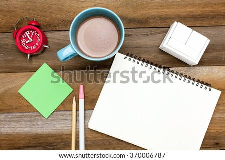 Business concept: Clock,post it,chocolate mug,blank space diary,blank wooden block calendar ,pencil and pen on wooden blackground - stock photo
