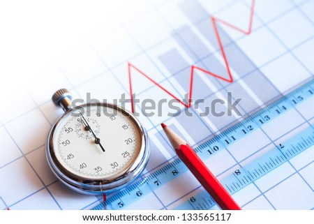 Business concept. Closeup of stopwatch and red pencil on paper background with business chart - stock photo