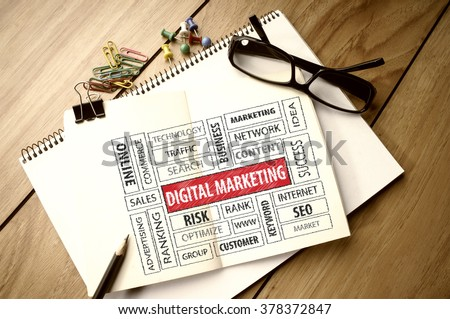 Business Concept: Digital Marketing word cloud on notebook - stock photo