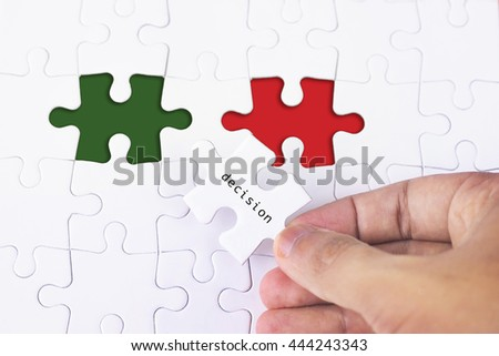 Business Concept - Female hand and missing puzzle with Decision word - stock photo