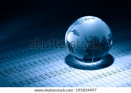 Business concept. Glass globe on background with table of numbers - stock photo