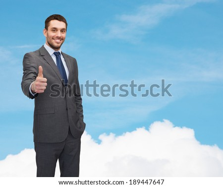 business concept - handsome businessman showing thumbs up - stock photo