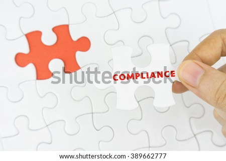Business concept. Missing jigsaw puzzle piece with COMPLIANCE word. - stock photo
