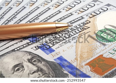 Business concept - money and pen - stock photo