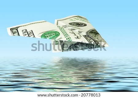 business concept. money plane under water - stock photo