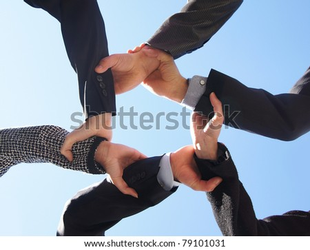 Business concept of some hands over sky background - stock photo