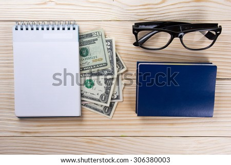 Business concept, office work. Financial Accounting - money, notepad, glasses on wooden background. Copy space. - stock photo