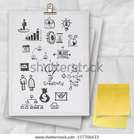 business concept on white book and sticky note with crumpled paper as concept - stock photo