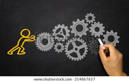 business concept:people activating gears mechanism - stock photo