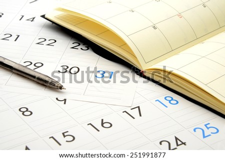Business concept, personal organizer on calender - stock photo