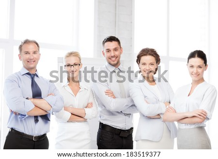 business concept - picture of happy business team in office - stock photo