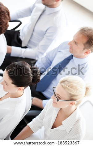 business concept - picture of smiling businessmen and businesswomen on conference - stock photo