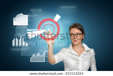 Business concept. Pretty young woman in office suit touch in screen with icons and graphic - stock photo