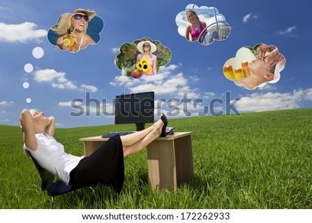 Business concept shot of a beautiful young woman relaxing at a desk in a green field day dreaming, of being on holiday. Dream clouds fill the blue sky.  - stock photo