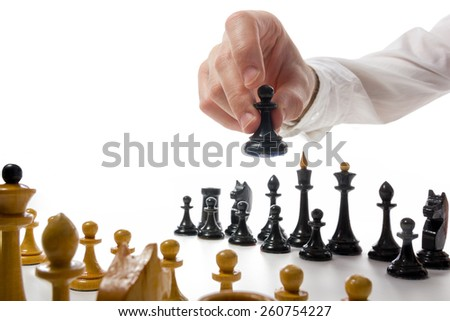 Business concept strategy, leadership, team and success. Businessman playing chess game selective focus. Makes first move - stock photo