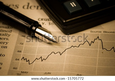Business concept The calculator, pen and diagram - stock photo