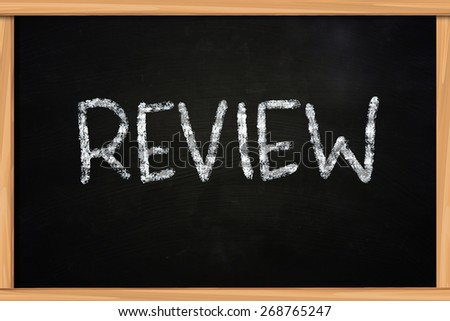 Business concept the word Review written with chalk on blackboard - stock photo