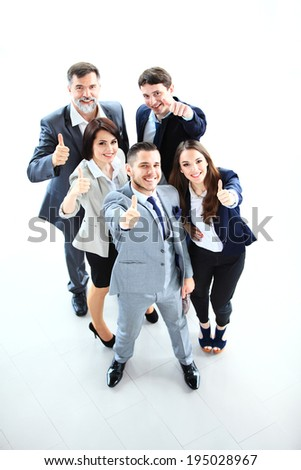 business concept - Top view of successful young business people showing thumbs up - stock photo