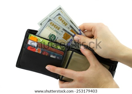 Business concept. Wallet with credit cards and dollars in woman hands isolated on white background - stock photo