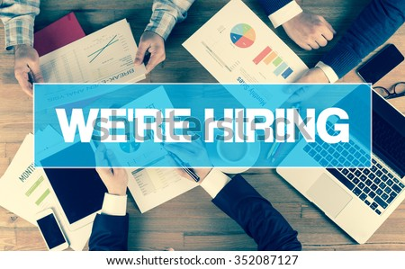 Business Concept: WE'RE HIRING - stock photo