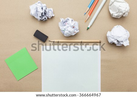 Business concept:white blank paper,crumpled paper and color pencil,pencil,pen on brown paper background - stock photo