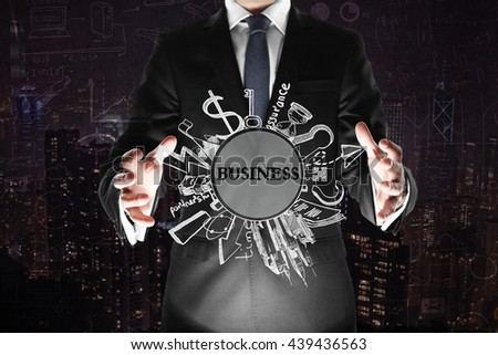 Business concept with businessman holding sketch on dark city background with business charts - stock photo