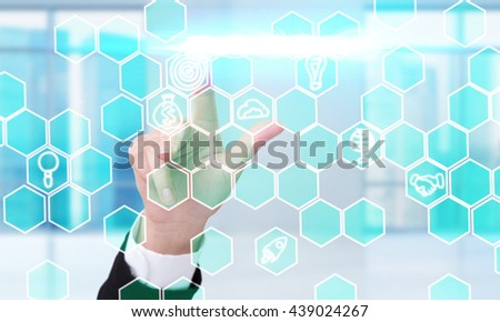 Business concept with businesswoman hand pressing digital honeycomb patterns with business icons - stock photo