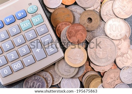 business concept with calculator and coins - stock photo