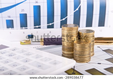 Business concept with calculator, glasses, money and documents - stock photo