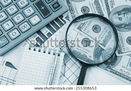 Business concept with calculator, notepad, money and documents - stock photo