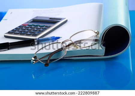 Business concept with notebook and calculator. - stock photo