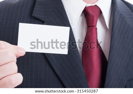 Business concept with white blank empty card and elegant suit and tie - stock photo