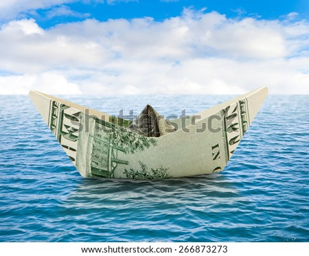Business concepts - ship from dollar money on water - stock photo