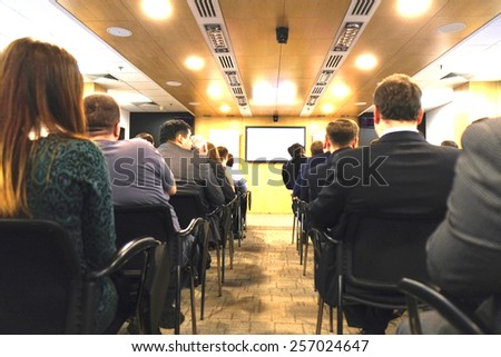 Business Conference and Presentation. Audience at the conference hall - stock photo