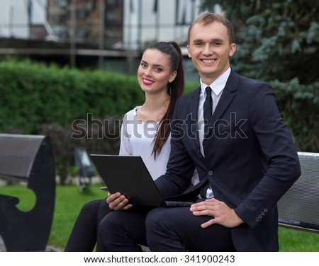 Business confidence and partnership. Business portrait of two young confident and successful business partners working  on the project. Business team at work. Business background - stock photo