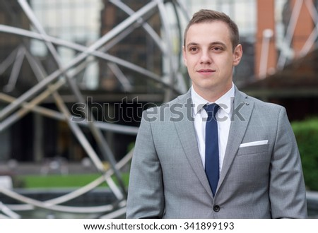 Business confidence. Business portrait of young confident and successful businessman working  on the project. Businessman at work. Business background - stock photo