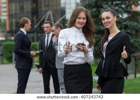 Business confidence. Portrait of two motivated businesswoman. Female colleagues  at work. Outdoors business concept - stock photo