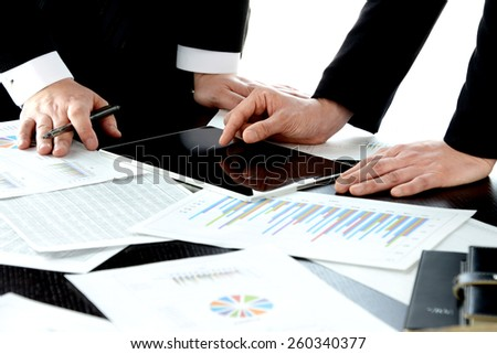 Business consept, meeting with digital tablet - stock photo
